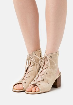 AGATA  - Ankle cuff sandals - camel