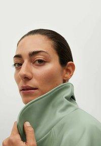 Mango - CREAM - Faux leather jacket - pastellgrün - 3