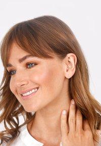 Elli - Earrings - gold - 1