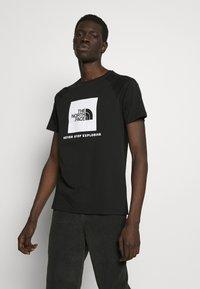 The North Face - RAGLAN TEE  - Print T-shirt - black/white - 0
