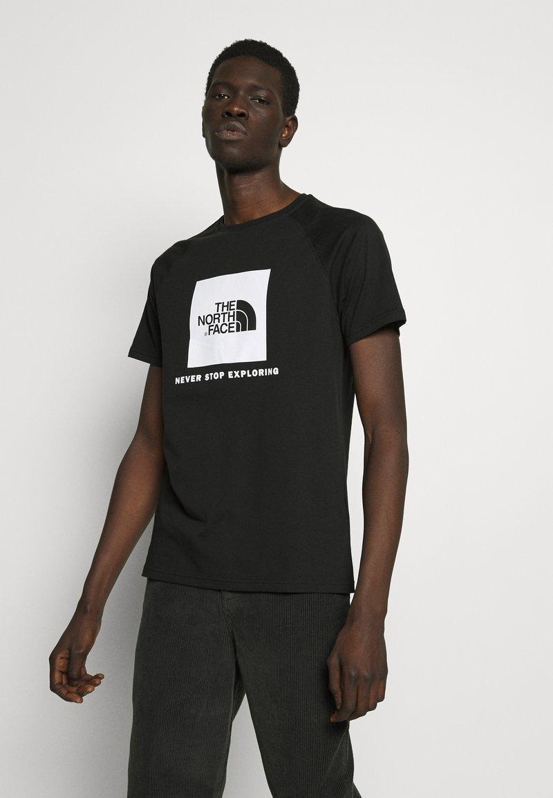 The North Face - RAGLAN TEE  - Print T-shirt - black/white