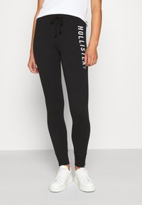 Hollister Co. - TIMELESS - Tracksuit bottoms - black - 0
