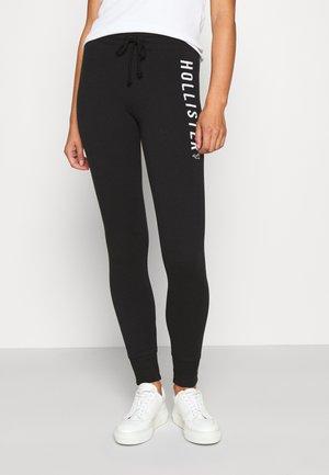 TIMELESS - Spodnie treningowe - black