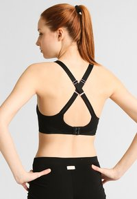 triaction by Triumph - TRIACTION MAGIC MOTION  - Sports bra - black - 1