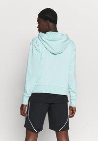 Nike Performance - STANDARD ISSUE HOODIE - Zip-up hoodie - light dew/pale ivory - 2