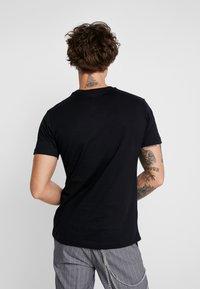 Diesel - DIEGO CUTY - Print T-shirt - black - 2