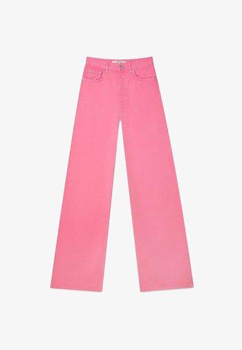 Jeansy Dzwony - neon pink