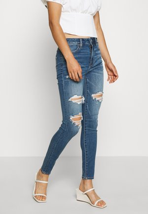 SUPER RISE JEGGING CROP - Jeggings - destroyed denim