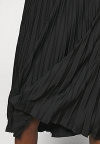 Calvin Klein - LOGO WAISTBAND PLEAT SKIRT - Jupe plissée - black - 4