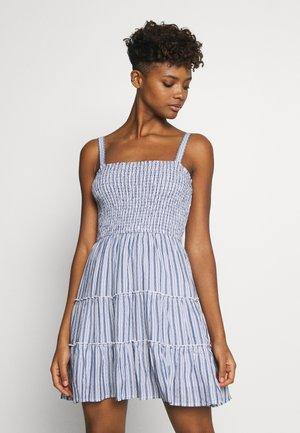 SMOCKED TIER BARE DRESS - Day dress - blue/white