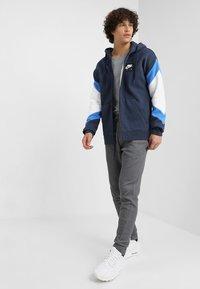 Nike Sportswear - OPTIC - Tracksuit bottoms - dark grey/heather - 1
