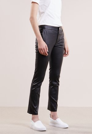 LEYA - Leather trousers - black