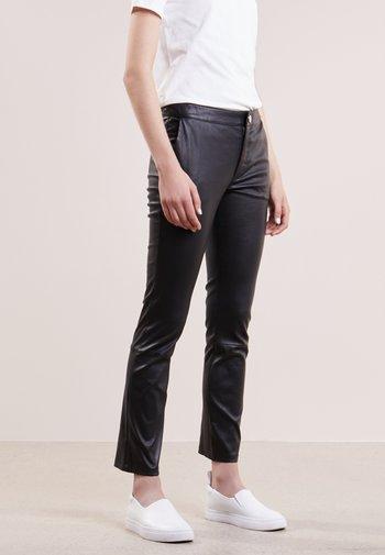 LEYA - Leather trousers - black
