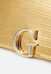 Guess - CORILY CONVERTIBLE XBODY FLAP - Across body bag - gold-coloured - 4