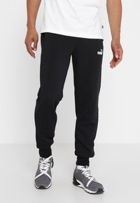 Puma - ESS LOGO PANTS - Pantalon de survêtement - black - 0