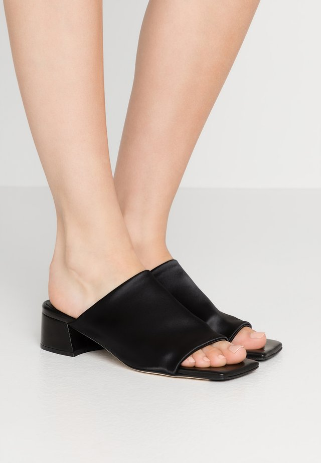 CATERINA - Mules - black