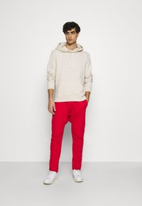 Schott - PAUL - Tracksuit bottoms - red - 1