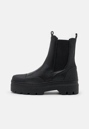 VIOLA  - Platform ankle boots - black garda