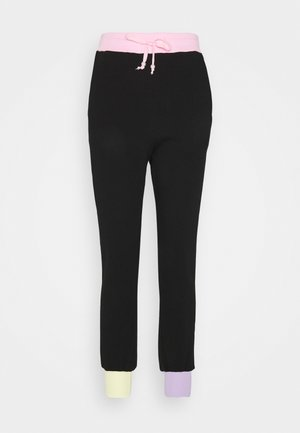 TILDA - Tracksuit bottoms - black