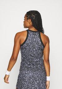 Nike Performance - DRY TANK PRINTED - Camiseta de deporte - black/white - 2