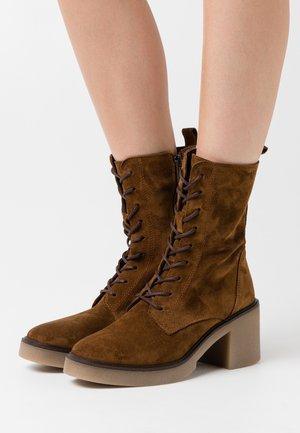 KANDY  - Platform ankle boots - cognac