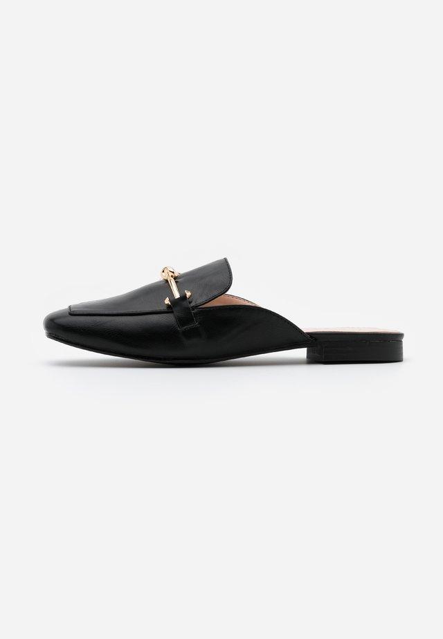 LOGAN - Sandalias planas - black