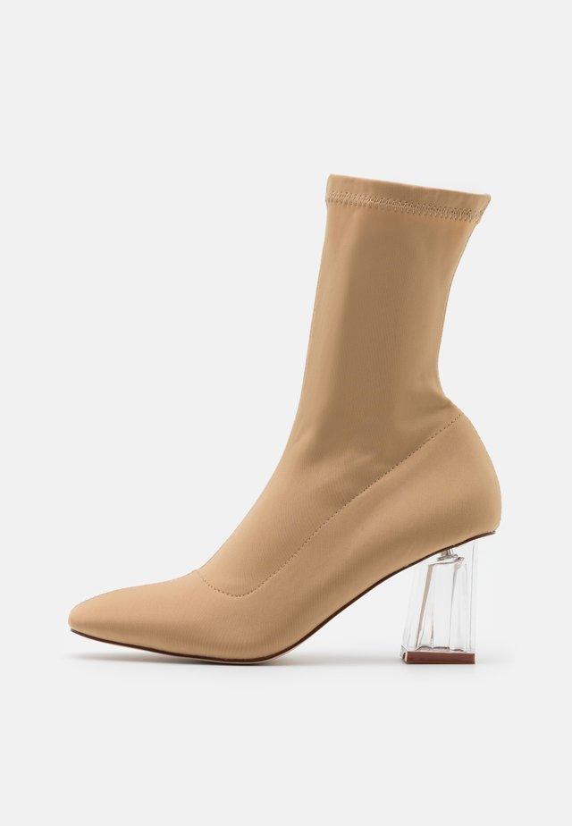 DORI - Classic ankle boots - nude