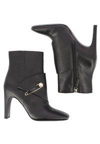 Nine West - High heeled ankle boots - black - 3