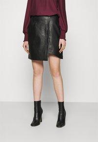 Vero Moda - VMZISSY SHORT COATED SKIRT  - Mini skirt - black - 0