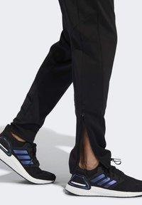 adidas Performance - OWN THE RUN ASTRO JOGGERS - Tracksuit bottoms - black - 4