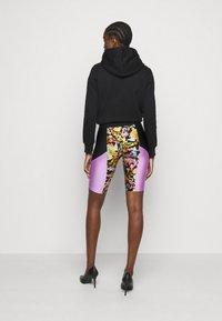 Versace Jeans Couture - LADY FUSEAUX - Shorts - black - 2