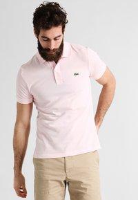 Lacoste - Polo shirt - flamingo - 0