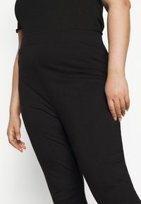 Even&Odd Curvy - SEMI FLARED - Leggings - black - 3