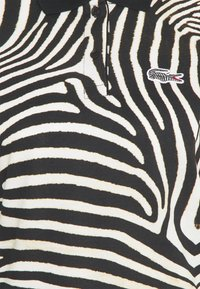 Lacoste - Polo shirt - zebra - 2