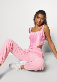 adidas Originals - JOGGER - Tracksuit bottoms - lightpink - 3