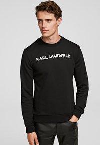 KARL LAGERFELD - GRAFFITI - Sweatshirt - black - 0