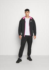 Nike Sportswear - Summer jacket - black/pinksicle - 1