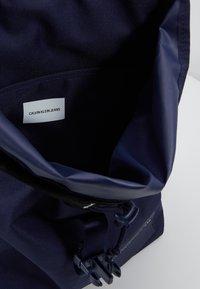 Calvin Klein Jeans - LOGO TAPE FLAP BACKPACK - Rucksack - blue - 5