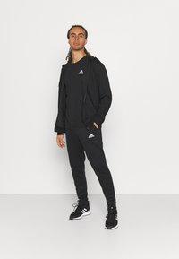 adidas Performance - ESSENTIALS - Basic T-shirt - black - 1