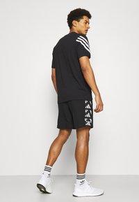 adidas Performance - CELEB SHORT - Urheilushortsit - black/white - 2