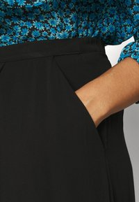 NU-IN - BUTTON UP MIDI SKIRT - A-line skirt - black - 3