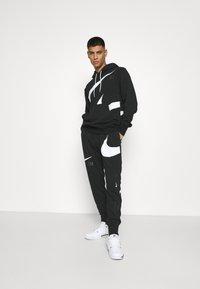 Nike Sportswear - HOODIE - Sudadera - black/(white) - 6