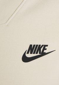 Nike Sportswear - M NSW TCH FLC LS FNL - Sweatshirt - beach/black - 2