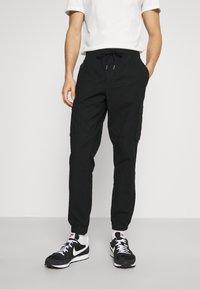 GAP - JOGGER - Cargo trousers - true black - 0