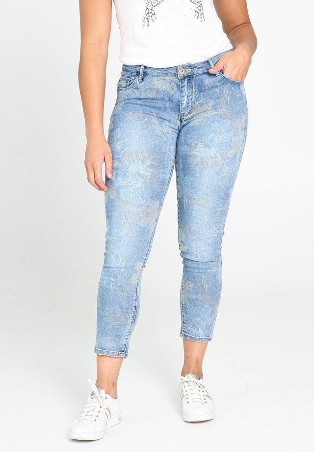 MIT TROPISCHEM AUFDRUCK - Jeans Skinny Fit - denim