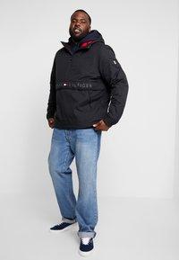 Tommy Hilfiger - STRETCH ANORAK - Light jacket - black - 1