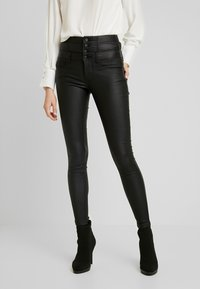 ONLY - ONLCORAL CORSAGE ROCK COATED - Pantalon classique - black - 0