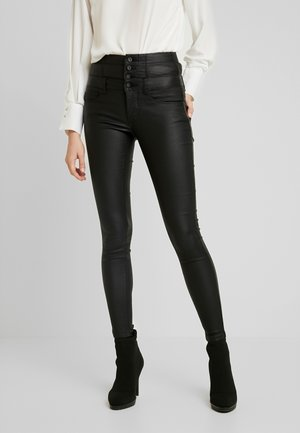 ONLCORAL CORSAGE ROCK COATED - Pantalones - black