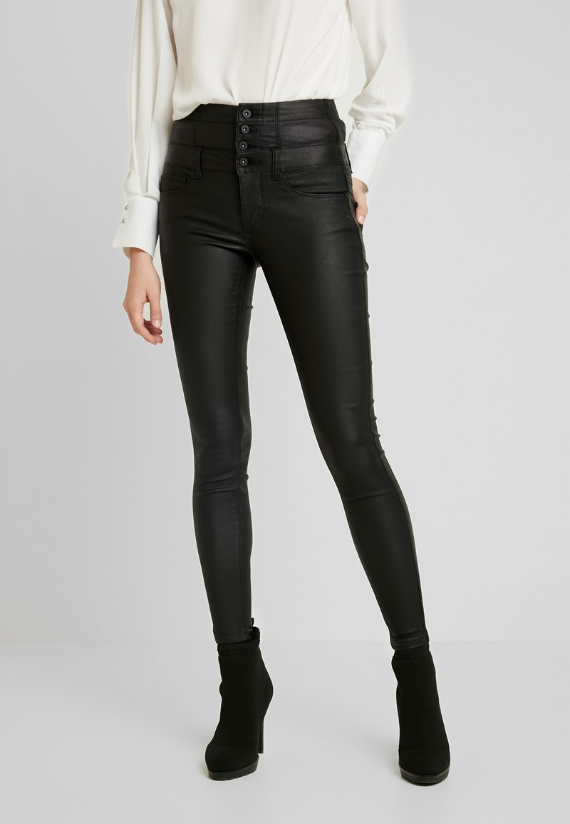 ONLY - ONLCORAL CORSAGE ROCK COATED - Pantalon classique - black