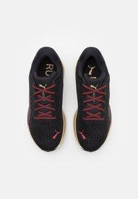 Puma - MAGNIFY NITRO - Neutral running shoes - black/sunblaze - 3